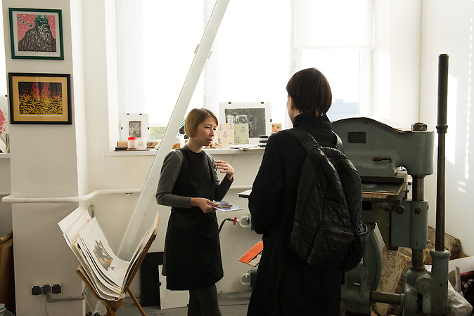 UA / Ukraine / Kyiv / 29.10.2015 / Two artists having conversation in lithography lab of Izolyatsia (Platform of Cultural Initiatives). Center moved from Donetsk region to Kiev with all employees in 2014, where the building was occupied and robed.