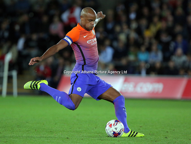 Vincent Company of Manchester City kicks the ball forward during the EFL Cup Third Round match between Swansea City and Manchester City at The Liberty Stadium in Swansea, Wales, UK. Wednesday 21 September.