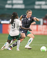 Abby Wambach #20 of the Washington Freedom bursts past Eniola Aluko #9 of St. Louis Athletica during a WPS match on May 1 2010, at RFK Stadium, in Washington D.C. Freedom won 3-1.