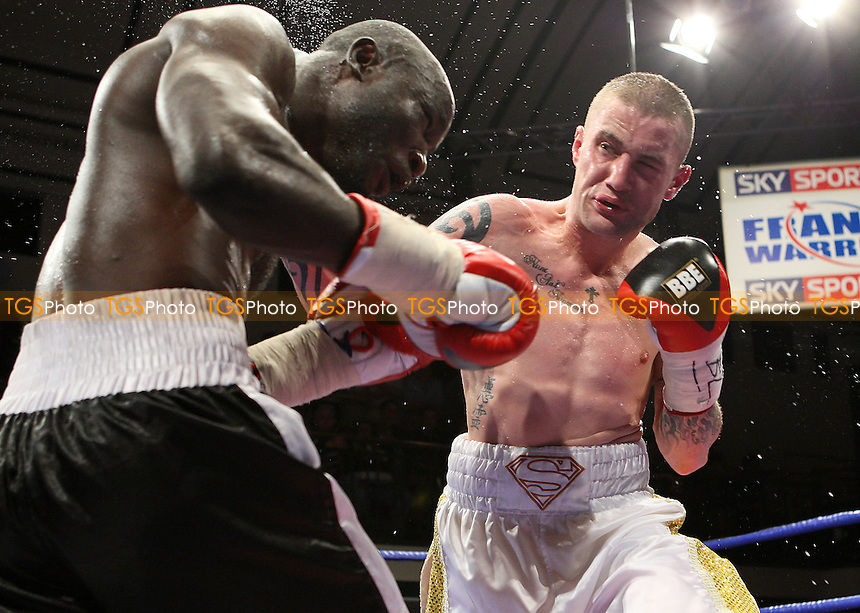 Ricky Burns (Glasgow, white shorts) defeats Osumanu Akaba (Accra, Ghana, black shorts) in a Super-Featherweight boxing contest for the Commonwealth Title at York Hall, Bethnal Green, promoted by Frank Warren, Sports Network - 26/09/08 - MANDATORY CREDIT: Gavin Ellis/TGSPHOTO - Self billing applies where appropriate - 0845 094 6026 - contact@tgsphoto.co.uk - NO UNPAID USE.