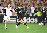 Dejan Jakovic #5 of D.C. United makes a pass in front of Zack Schilawski #15 of the New England Revolution during an MLS match on April 3 2010, at RFK Stadium in Washington D.C.