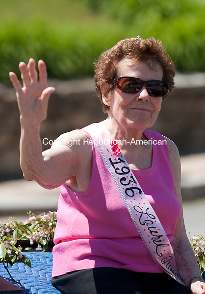 WINSTED, CT--061315JS07- 1936 Laurel Queen Virginia Hurlbut McMahon waves as she rides on the back of a car  during the 2015 Laurel Festival Parade and ceremonies in Winsted on Saturday.<br /> Jim Shannon Republican-American