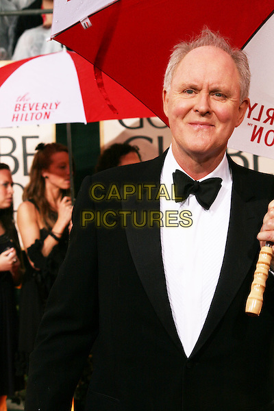 JOHN LITHGOW .Arrivals at the 67th Golden Globe Awards, he Beverly Hilton Hotel, Beverly Hills, California, USA, .January 17th, 2010..globes half length black bow tie tux tuxedo umbrella raining .CAP/AW/MAZ .©Maz/Weber/Capital Pictures.