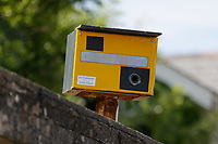 A fake speed camera on a wall at St Bride's Major village in the Vale of Glamorgan, south Wales, UK. 21 June 2018