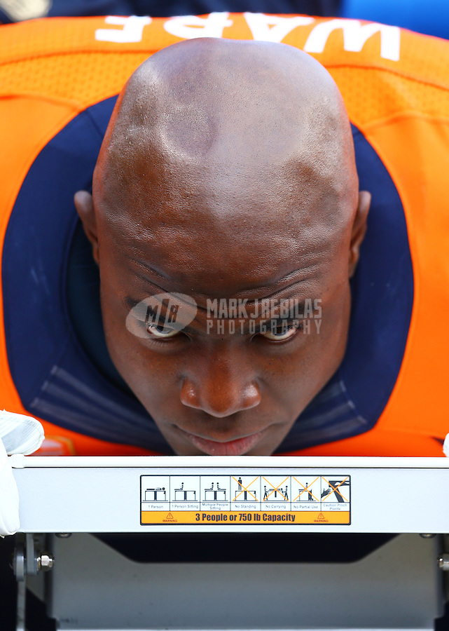 Jan 24, 2016; Denver, CO, USA; Denver Broncos defensive end DeMarcus Ware (94) reacts as he lays on a table being tended to by a trainer on the sidelines against the New England Patriots in the AFC Championship football game at Sports Authority Field at Mile High. The Broncos defeated the Patriots 20-18 to advance to the Super Bowl. Mandatory Credit: Mark J. Rebilas-USA TODAY Sports