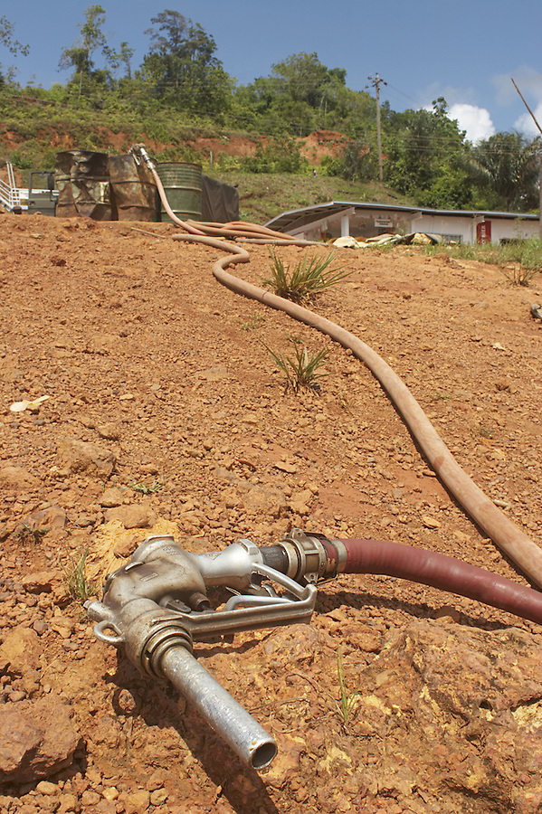 Gasoline filling hose lying on the beach in the port town of Affobaka on the Brokopondo reservoir, Suriname.