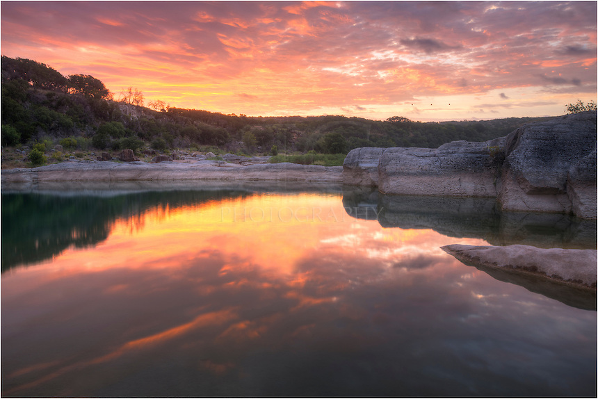 While I had planned on photographing the Milky Way on this photo trip to Pedernales Falls, my plans got derailed when the skies were mostly cloudy. So I waited around in this little sanctuary in the Texas Hill Country hoping for some nice colors at sunrise. I was rewarded for my patience as the clouds and sky lit up in reds and blues - if only for about 5 minutes- before ushering the morning light and blue skies.