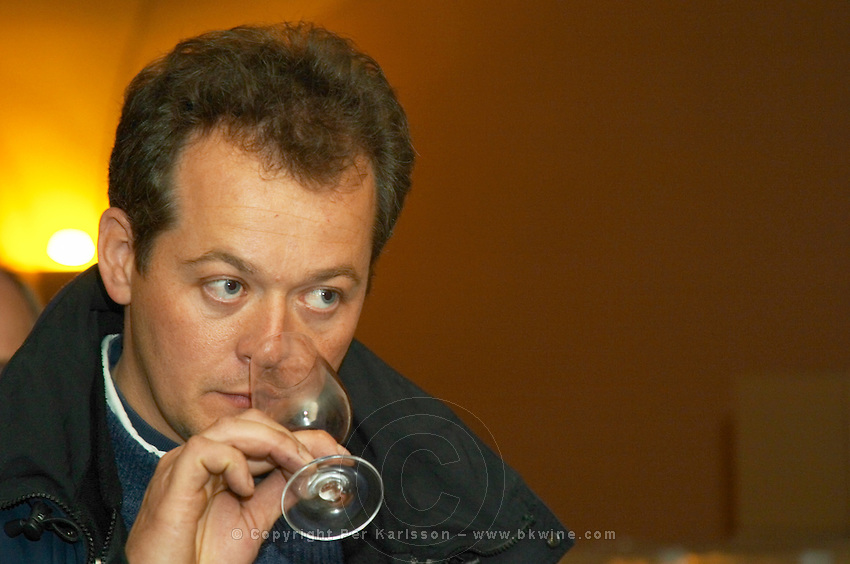 Gilles Robin, owner and winemaker tasting a glass of wine.  Domaine Gilles Robin, Les Chassis, Mercurol, Drome, Drôme, France, Europe