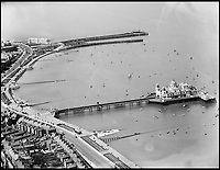 BNPS.co.uk (01202 558833)<br /> Pic: Aerofilms/HistoricEngland/BNPS<br /> <br /> Morecombe, June 1933.<br /> <br /> Stunning historic aerial photos of seaside towns, naval bases, ports and shipyards which tell the story of Britain's once-great maritime tradition feature in a new book.<br /> <br /> The fascinating archive of black and white images includes views from a bygone age such as Brighton's famous West Pier, Grimsby's burgeoning fishing fleet, and London's dock yards.<br /> <br /> Iconic ships were also captured from the skies including the Cutty Sark in its final seaworthy years on the Thames, HMY Britannia in 1959, the RMS Queen Mary in 1946 and the SS Queen Elizabeth in 1969 about to make her maiden voyage.<br /> <br /> England's Maritime Heritage from the Air, by Peter Waller, is published by English Heritage and costs &pound;35.