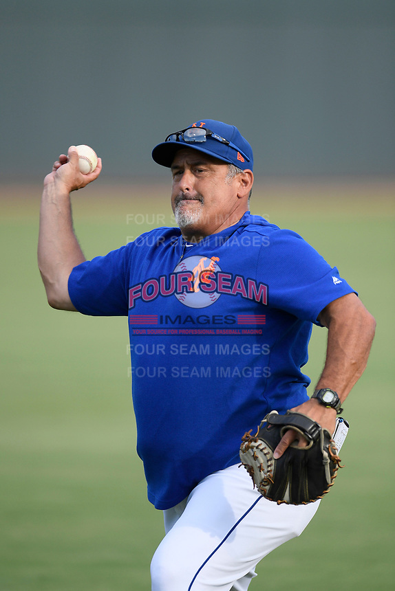 New York Mets Minor League Catching Coordinator Rob Natal warms up the Columbia Fireflies' catcher before a game against the Charleston RiverDogs on Friday, July 12, 2019 at Segra Park in Columbia, South Carolina. The RiverDogs won, 4-3, in 10 innings. (Tom Priddy/Four Seam Images)