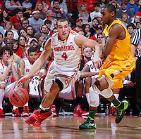 Ohio State Buckeyes guard Aaron Craft (4) is guarded by North Dakota State Bison guard Kory Brown (22) during Saturday's NCAA Division I basketball game at Value City Arena in Columbus on December 14, 2013. Ohio State won the game 79-62. (Barbara J. Perenic/The Columbus Dispatch)