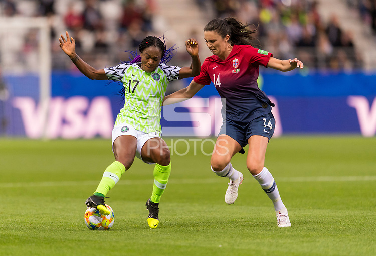 REIMS, FRANCE - JUNE 08: Francisca Ordega #17 tries to dribbles past Ingrid Syrstad Engen #14 during a game between Norway and Nigeria at Stade Auguste-Delaune on June 8, 2019 in Reims, France.
