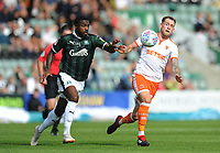 Plymouth Argyle's Yann Songo'o vies for possession with Blackpool's Harry Pritchard<br /> <br /> Photographer Kevin Barnes/CameraSport<br /> <br /> The EFL Sky Bet League One - Plymouth Argyle v Blackpool - Saturday 15th September 2018 - Home Park - Plymouth<br /> <br /> World Copyright &copy; 2018 CameraSport. All rights reserved. 43 Linden Ave. Countesthorpe. Leicester. England. LE8 5PG - Tel: +44 (0) 116 277 4147 - admin@camerasport.com - www.camerasport.com