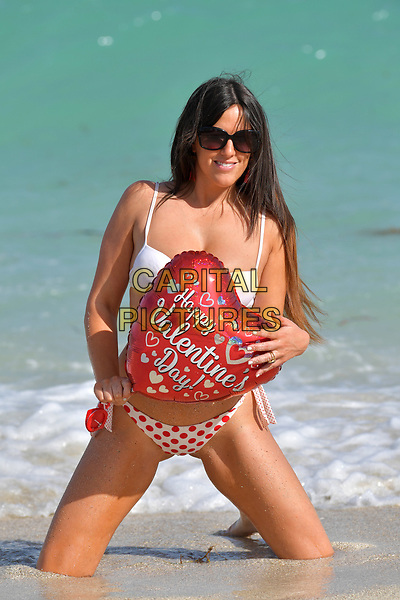 MIAMI BEACH, FL - FEBRUARY 14: (EXCLUSIVE COVERAGE) Star of French Reality show Secret story 9 and winner of the brunette girl of the year 2016 for Playboy Italy. Claudia Romani seen here wearing a red and white bikini on Valentine's Day. Claudia Romani is a model. She has appeared on covers such as GQ and Maxim, and in 2006 was voted one of the 100 Sexiest Women in the World by FHM Denmark on February 14, 2018 in Miami Beach, Florida. <br /> <br /> CAP/MPI122<br /> &copy;MPI122/Capital Pictures