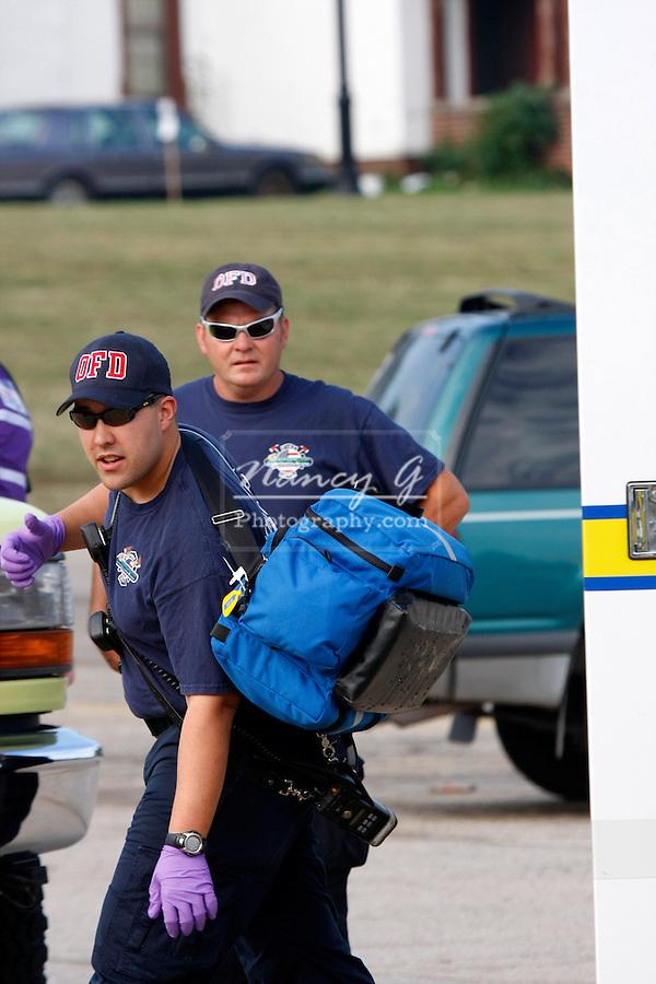 Two Oconomowoc Fire Department EMTs arrive at an emergency scene