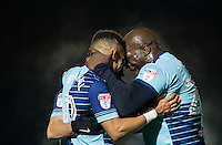 Adebayo Akinfenwa (right) of Wycombe Wanderers celebrates with Paris Cowan-Hall of Wycombe Wanderers at full time during the Sky Bet League 2 match between Wycombe Wanderers and Newport County at Adams Park, High Wycombe, England on 2 January 2017. Photo by Andy Rowland.