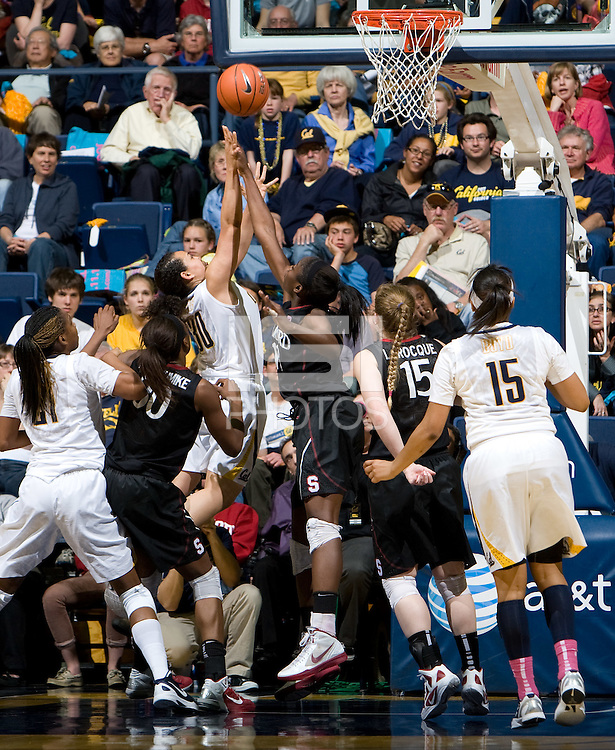 Berkeley, CA - March 4th, 2012: Nnemkadi Ogwumike of Stanford tries to block California's Mikayla Lyles's shot during a basketball game against California in Berkeley, California.   Stanford won, 86-61.