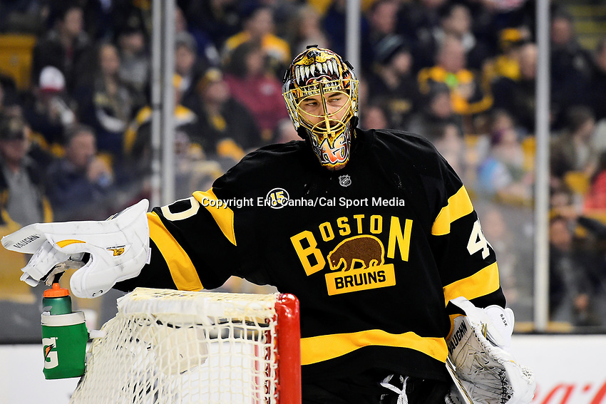 Monday, January 16, 2017: Boston Bruins goalie Tuukka Rask (40) reaches for his water bottle during a break in game play at the National Hockey League game between the New York Islanders and the Boston Bruins held at TD Garden, in Boston, Mass. New York defeats Boston 4-0.  Eric Canha/CSM
