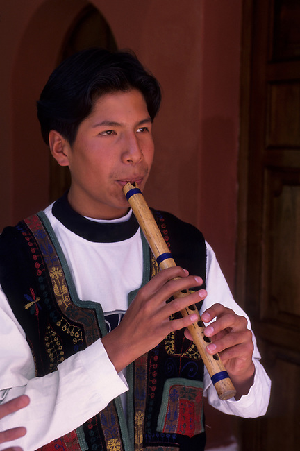 PERU, NEAR CUZCO, SACRED VALLEY, POSADA DEL INCA HOTEL, LOCAL MAN PLAYING FLUTE