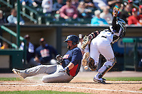 Toledo Mudhens designated hitter Casey McGehee (31) slides home as catcher Carlos Paulino can not come up with the throw during a game against the Rochester Red Wings on June 12, 2016 at Frontier Field in Rochester, New York.  Rochester defeated Toledo 9-7.  (Mike Janes/Four Seam Images)