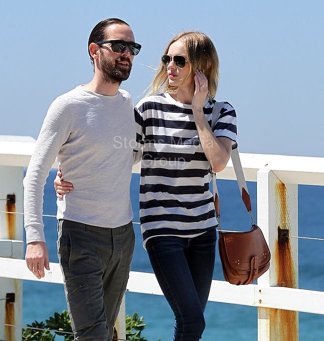 """SMG_Kate Bosworth_Michael Polish_FLXX_STRIPE_Just Married_083113_03.JPG<br /> <br /> BREAKING NEWS - ARCHIVE PHOTOS<br /> <br /> Kate Bosworth said """"I do"""" to director Michael Polish on Saturday during an outdoor ceremony at The Ranch at Rock Creek in Philipsburg, Montana, PEOPLE confirms.  The Superman Returns star, 30, met and fell in love with Polish, 42, when he directed her in the drama Big Sur in 2011. The sparks flew and it was love at first sight. """"I never even dated my husband-to-be,"""" Bosworth told InStyle UK in its September issue. """"He said to me after just a few weeks before we were even together, 'I'm going to marry you.' He just knew.""""  Bosworth confirmed her engagement in September of last year, Tweeting, """"Thank you for all the wonderful engagement wishes...We feel truly blessed.""""  As for wedding details of her big day, the Blue Crush actress revealed that the ceremony is """"not the norm and whisky will be involved.""""  This is the second marriage for Polish, who has teenage daughter, Jasper, with make-up artist Jo Strettell. They divorced in 2004.<br /> <br />  (Photo By Storms Media Group) <br /> <br /> People:  Kate Bosworth_Michael Polish<br /> <br /> Transmission Ref:  FLXX_STRIPE<br /> <br /> Must call if interested<br /> Michael Storms<br /> Storms Media Group Inc.<br /> 305-632-3400 - Cell<br /> 305-513-5783 - Fax<br /> MikeStorm@aol.com"""