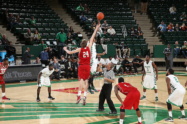Denton, TX - NOVEMBER 14: Liam Thomas #24 of the Nicholls State University Colonels and Armani Flannigan #4 of the North Texas Mean Green tip off the start of the game at Super Pit - North Texas Coliseum  in Denton on November 14, 2013 in Denton, Texas. (Photo by Rick Yeatts)
