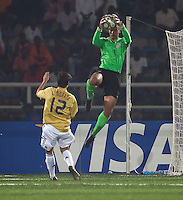 Earl Edwards (1) jumps above Alvaro Morata (12) for the save. Spain defeated the U.S. Under-17 Men National Team  2-1 at Sani Abacha Stadium in Kano, Nigeria on October 26, 2009.
