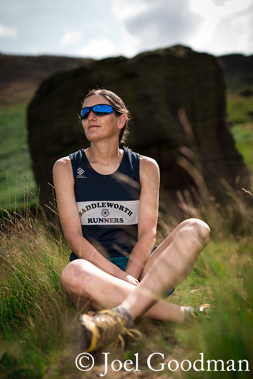 © Joel Goodman - 07973 332324 . 21/07/2014 . Oldham , UK . Gaynor at Sugarloaf rock on the moors above Dovestone Reservoir . Runner GAYNOR KEANE recently completed the Bob Graham Challenge in under 24 hours . Photo credit : Joel Goodman