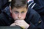 © Joel Goodman - 07973 332324 . 17/05/2015 .  Old Trafford , Manchester , UK . Manchester United fan watching the match . Manchester Utd vs Arsenal at Old Trafford Football Stadium , Manchester . Photo credit : Joel Goodman