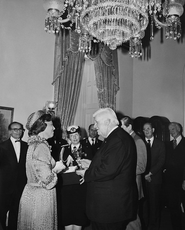 """Speaker of the House, Rep. Thomas Phillip """"Tip"""" O'Neill, House Majority Leader giving an award. (Photo by CJ Moore/CQ Roll Call)"""