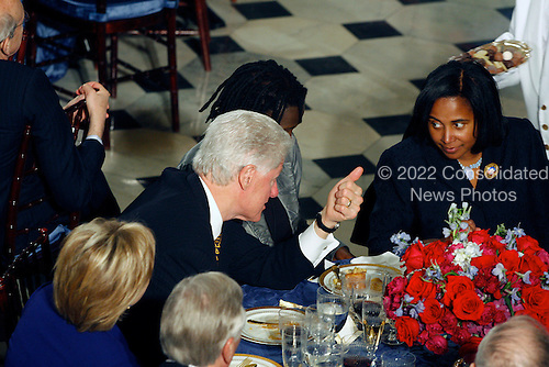 Washington, DC - January 20, 2009 -- Former United States President Bill Clinton converses with table mates at the Inaugural luncheon in Statuary Hall in the U.S. Capitol on Tuesday, January 20, 2009. Secretary of State designate, Senator Hillary Rodham Clinton (Democrat of New York) is at left..Credit: Harry Hamburg - Pool via CNP