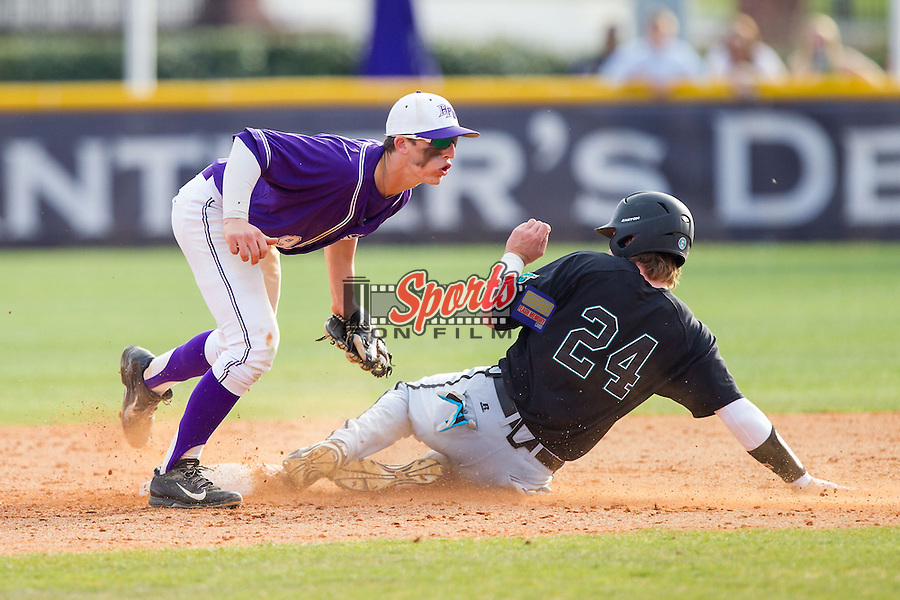 Chris Clare (9) of the High Point Panthers applies the tag to Colin Hering (24) of the Coastal Carolina Chanticleers as he attempts to steal second base at Willard Stadium on March 15, 2014 in High Point, North Carolina.  The Chanticleers defeated the Panthers 1-0 in the first game of a double-header.  (Brian Westerholt/Sports On Film)