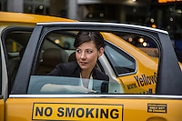 Attractive business woman in taxi cab arrives at the Austin–Bergstrom International Airport (ABIA) to catch a flight.