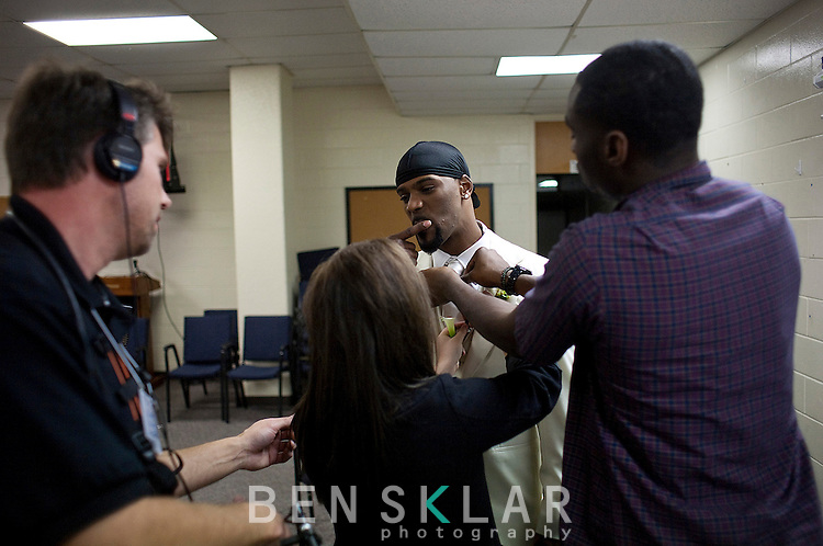 Aaron Ross, New York Giants cornerback, gets last minute styling and microphone checks before his wedding to Sanya Richards, Olympic gold medalist, at the Hyde Park Baptist Church in Austin, Texas on Friday, February 26, 2010. The couple met while participating in the athletics programs at the University of Texas...