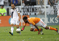 CARSON, CA - DECEMBER 01, 2012:   Landon Donovan (10) of the Los Angeles Galaxy slips the ball past Giles Barnes (23) of the Houston Dynamo during the 2012 MLS Cup at the Home Depot Center, in Carson, California on December 01, 2012. The Galaxy won 3-1.