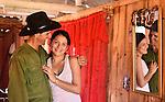 A Cuban tobacco farmer embraces his  teenage daughter  near Vinales Cuba
