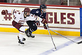 Zach Walker (BC - 14), Alexander Payusov (UConn - 9) - The Boston College Eagles defeated the visiting UConn Huskies 2-1 on Tuesday, January 24, 2017, at Kelley Rink in Conte Forum in Chestnut Hill, Massachusetts.