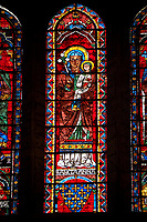 Medieval Window of the North Transept of the Gothic Cathedral of Chartres, France- Circa 1235. A UNESCO World Heritage Site. The panels depicts Saint Anne carrying the infant Mary with The arms of the Royal House of France below.