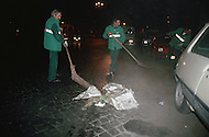 "April 27, 1990, Rome, Italy. Photographing for the book ""One day in the life of Italy"", this is an exploration of Rome. In Lungotevere at 4:30am, men clean the street."