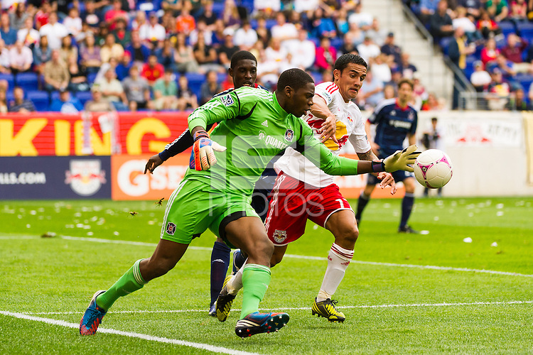 Chicago Fire goalkeeper Sean Johnson (25) takes the ball away from Tim Cahill (17) of the New York Red Bulls during a Major League Soccer (MLS) match at Red Bull Arena in Harrison, NJ, on October 06, 2012.