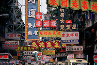Colourful by both day and night, neon signs loom large above pedestrians and traffic cramming a busy shopping street in Causeway Bay on Hong Kong island. Space is always at a premium in Hong Kong, especially on the narrow strip of flat land near the waterfront.