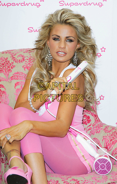 JORDAN - KATIE PRICE .Launches Jordan Haircare Electricals at Superdrug, Kensington High Street, London, England..October 25th 2007.full length sitting pink leggings tattoo straighteners ring diamond earrings nail varnish polish hairdryer dress.CAP/ROS.©Steve Ross/Capital Pictures