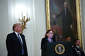 Susan Rescorla, the widow of Richard Rescorla, accepts the Presidential Citizens Medal from United States President Donald J. Trump on her late husband's behalf in the East Room of the White House in Washington D.C., U.S. on Thursday, November 7, 2019.  Rescorla helped save the lives of nearly 2,700 people at the World Trade Center in New York City on September 11, 2001.   <br /> <br /> Credit: Stefani Reynolds / CNP