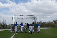 18 April 2006: Players push a batting cage during the third of seven 2006 MLB European Academy Try-out Sessions throughout Europe, at Stade Pershing, INSEP, near Paris, France. Try-out sessions are run by members of the Major League Baseball Scouting Bureau with assistance from MLBI staff.