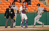 Designated hitter Matthew Ramsay (19) of the Wofford Terriers scores a run on an errant throw in the sixth inning of a a game against the Clemson Tigers on Wednesday, March 6, 2013, at Doug Kingsmore Stadium in Clemson, South Carolina. Clemson won, 9-2. (Tom Priddy/Four Seam Images)