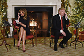United States President Donald J. Trump and the First Lady Melania Trump participate in NORAD Santa Tracker phone calls in the East Room of the White House in Washington, D.C on December 24, 2018.<br /> Credit: Olivier Douliery / Pool via CNP