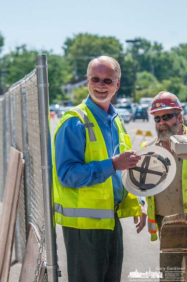 Hadler Company CEO George Hadler prepares to begin demolition of a large portion of Westerville Square Shopping Center to make way for the construction of a new WalMart store in the Columbus suburb. The store will approximately 108,000-square-feet, about half the  size of a traditional WalMart super store..