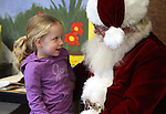 Jillian Foster, 4, talks to Santa during Storytime at the Carson City Library on Thursday, Dec. 13, 2012. .Photo by Cathleen Allison