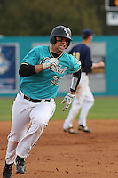 Jose Iglesias #35 of the Coastal Carolina University Chanticleers rounding third base during a game against the University of Michigan Wolverines at the Carvelle Resort Classic Tournament held at Watson Stadium at Vrooman Field in Conway, SC on March 13, 2010. Photo by Robert Gurganus/Four Seam Images