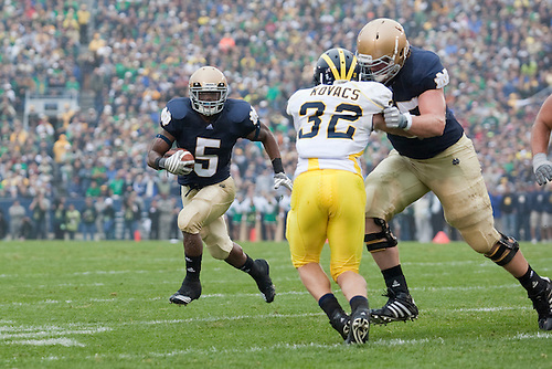 Notre Dame tailback Armando Allen Jr. (#5) runs the ball during NCAA football game between the Notre Dame Fighting Irish and the Michigan Wolverines.  Michigan defeated Notre Dame 28-24 in game at Notre Dame Stadium in South Bend, Indiana.